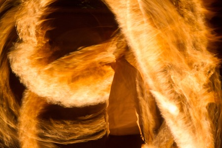 firestorm: silhouette of a man on yellow firestorm Stock Photo