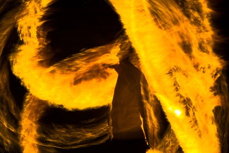 firestorm: silhouette of a man on orange fire Stock Photo