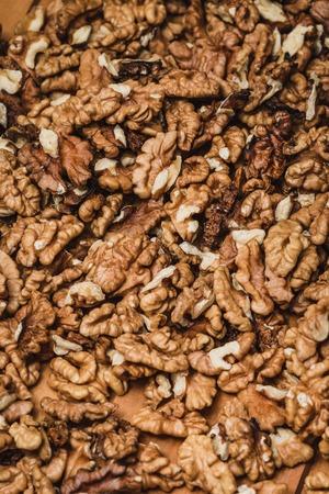 Closeup of big shelled walnuts pile background Stock Photo