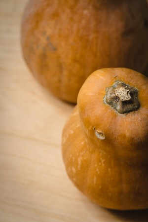 Two pumpkins on wooden table. Top view Stock Photo