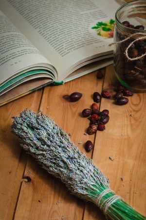 The composition of the tools of natural healing herbs and dried berries in the bank