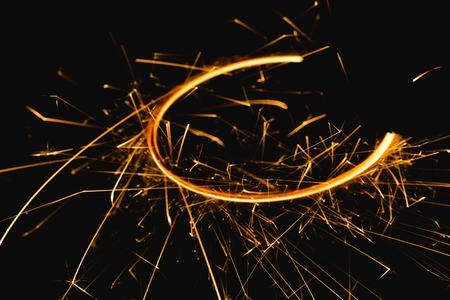 Radial trail of sparks that glow in the dark