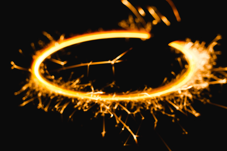 abstract background blur Radial trail of sparks that glow in the dark