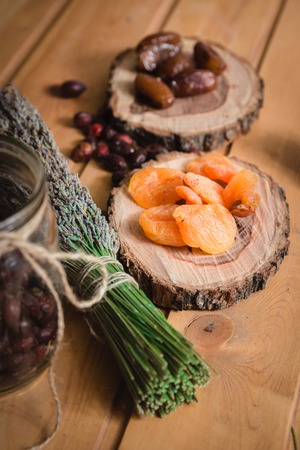 dried dates and apricots on wooden plates