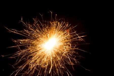 Sparkler lit in the dark Stock Photo