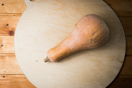 pumpkin on a round cutting board