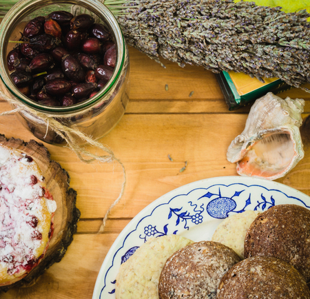 plate with dried fruits and cakes on wooden saucers Stock Photo