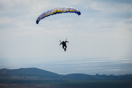 paraglider above the bay in sky