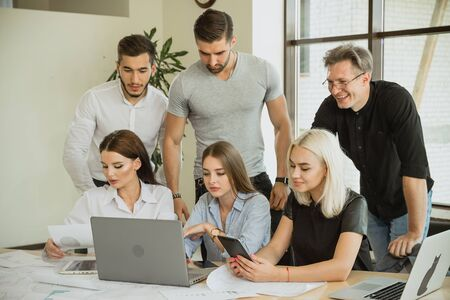 Young employees are involved in the work. They are happy to take on a new project where everyone is busy with their own business. To the manifestations of team and organizational solidarity