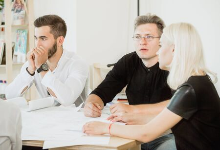 Desperation and hopeless in faces of employees in project meeting