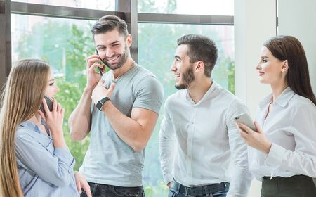 a company of friends, employees make a telephone prank Stock Photo