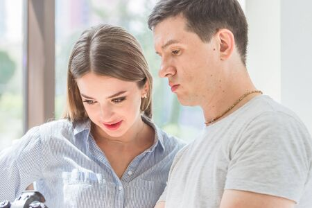 young man shows a young woman a camera Stock Photo