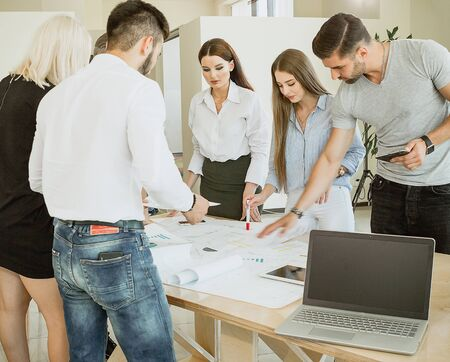 A new team of young professionals brings order to the design of the previous team. Stock Photo