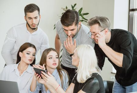 Young employees during the work process. Question and not perception on the faces The decision came to a standstill Deadline and Hopeless Situation Stock Photo