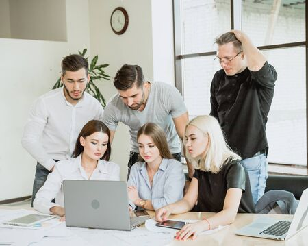 Young students process information received through the network on a laptop Testing the acquired skills to the extent that people can quickly make decisions critical thinking ability Stock Photo