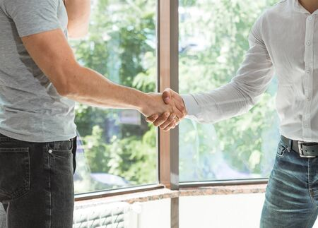 Close Up of two shaking male hands Casual wear