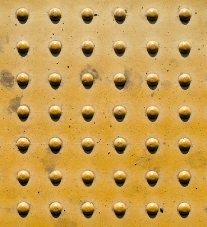convex shape: Stone brick wall for the blind.
