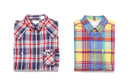 Two colored mens checkered shirts. Isolated on white background