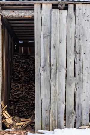 Village shed storing firewood for the winter Archivio Fotografico