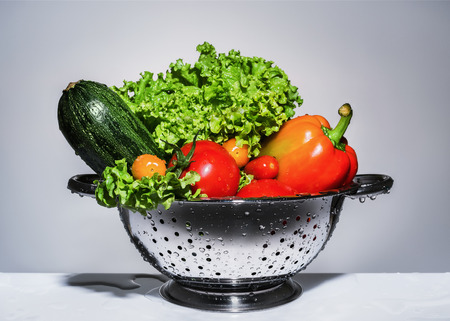 red food: Washed vegetables in a colander
