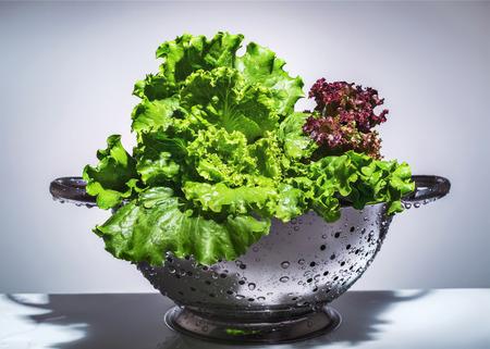 a colander: lettuce in a colander