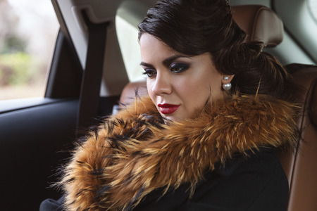 Caucasian woman: Glamorous lady in the car