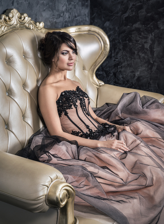 retro lady: A girl sitting in a ball gown dress