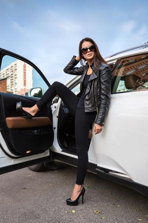 urban fashion: Brunette near the white car