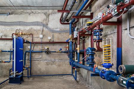 Plumbing in the basement Foto de archivo