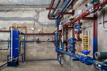 Plumbing in the basement Stock Photo