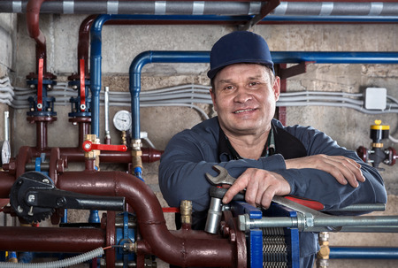 contractor: Portrait of plumbing engineer