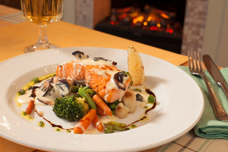 sauce dish: grilled salmon in white sauce with vegetables, restaurant dish