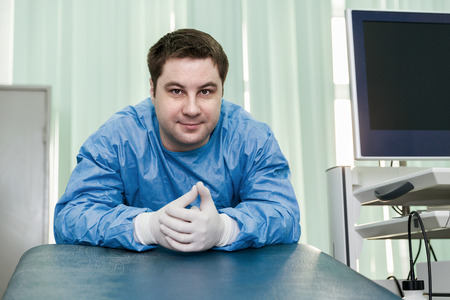 medical occupation: Young endoscope doctor in examine room Stock Photo