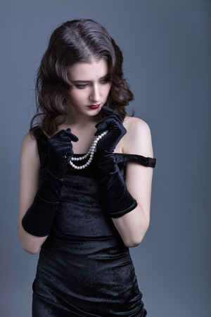 velvet dress: lady in a black velvet dress Stock Photo