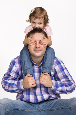 dad and daughter: father and young daughter on his shoulders