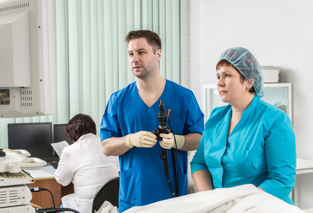 endoscopic: A doctor and a nurse at the monitor