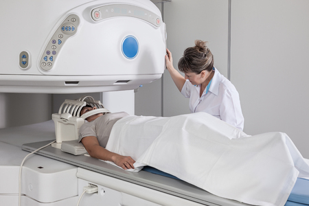 tomography: Patient does tomography of the head Stock Photo