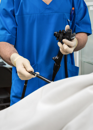Doctor with endoscope Stock Photo