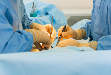 Surgeons' hands Standard-Bild