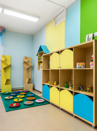 Kindergarten, toys on the shelves 版權商用圖片 - 53286289