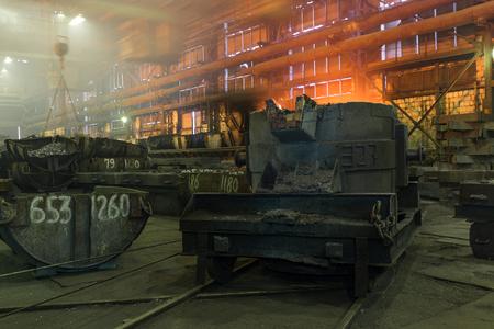 ironworks: Ironworks. Bucket with ore. Stock Photo