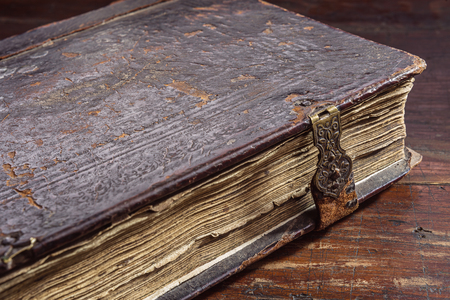 antique books: The ancient book on a table Stock Photo