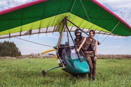 high powered: Ultralight aircraft and girl with the man. Stock Photo