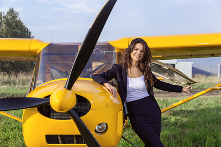airplane ultralight: Ultralight airplane and laughing brunette.