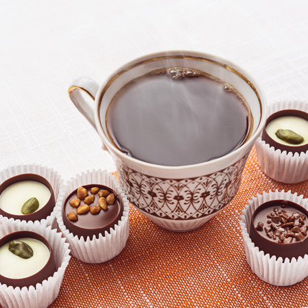 sweetstuff: Chocolate sweets and a cup of hot coffee.