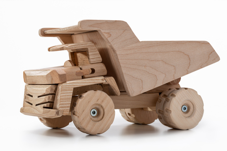 Miniature wooden toy car  truck in studio. Stock Photo