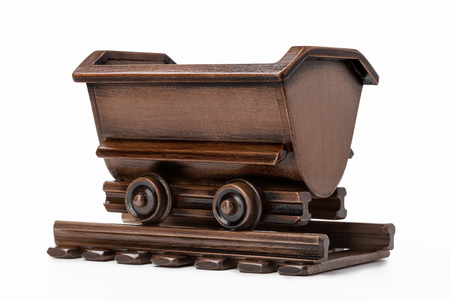 Mine cart toy for transporting coal and ore. Stock Photo