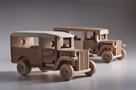 mirror image: Miniature wooden retro bus in the studio. Stock Photo