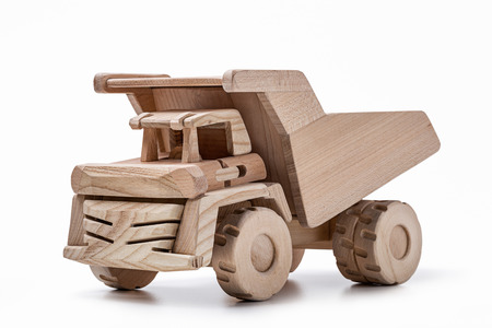 Model of a quarry dump truck made of natural wood.
