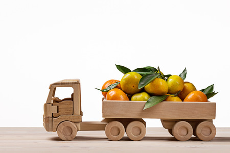 clementines: Toy truck with tangerines and clementines. Stock Photo
